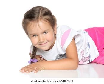 Beautiful Little Girl lying on white floor