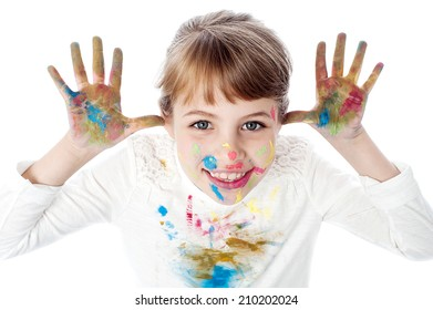 Beautiful little girl with messy hands of paint