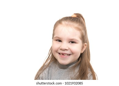 Beautiful little girl with the missing teeth,happy smiling, isolated on white background for any purpose