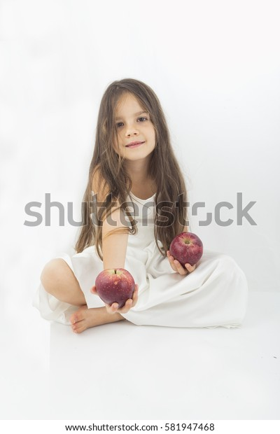 Beautiful little girl offering an  apple