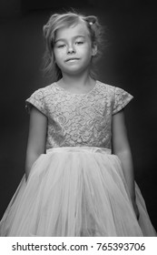Beautiful little girl on a black background. Studio photography
