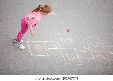 beautiful little girl on the hopscotch