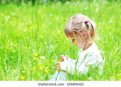 a beautiful little girl on the nature of