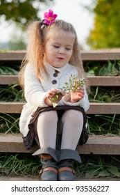 beautiful little girl on walk in autumn park