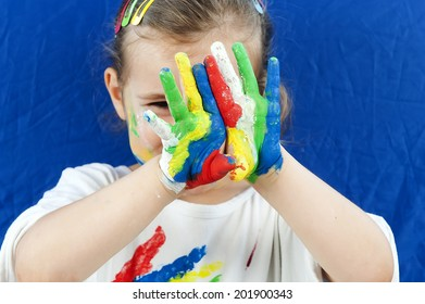 Beautiful little girl with paint of face