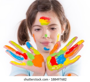 Beautiful little girl painting over white