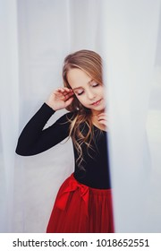beautiful little girl with perfect makeup and hair-dress with closed eyes