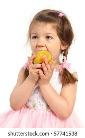 beautiful little girl with pigtails eating an apple