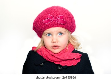 Beautiful little girl in a pink beret