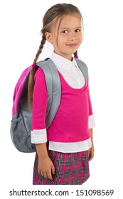 Beautiful little girl in pink school uniform and a backpack, isolated