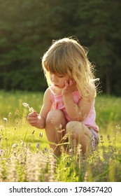 a beautiful little girl playing in nature