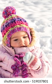 beautiful little girl playing in the snow, a cheerful mood