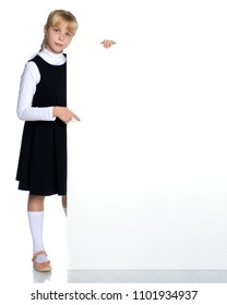 A beautiful little girl points a finger at an empty white banner in which you can insert text with your company's advertisement. The concept of promoting products in the market, children's emotions