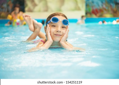 Beautiful little girl in pool water park.