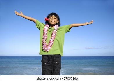 Beautiful little girl posing at the beach