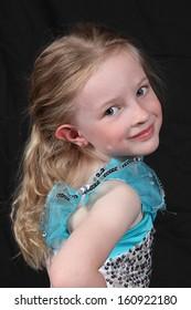 Beautiful Little Girl Posing for Camera in Studio