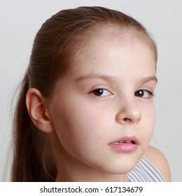 Beautiful little girl posing as a fashion model