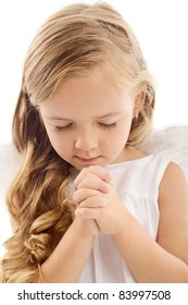 Beautiful little girl praying - closeup, isolated