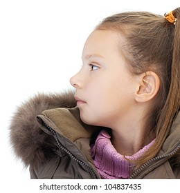 Beautiful little girl profile in warm winter jacket and pink sweater, isolated on white background.