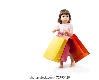 Beautiful little girl shopping colorful paper bags
