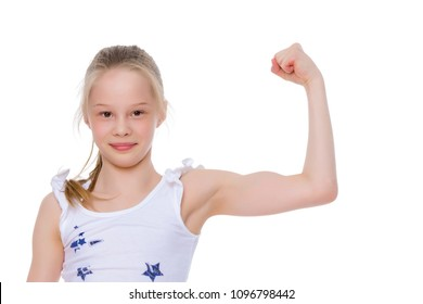 Beautiful little girl shows her muscles. The concept of strength, health and sport. Isolated on white background.