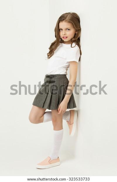 Girl with skirt image Beautiful Little Girl Skirt Standing Near Stock Photo Edit Now 323533733