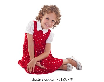 Beautiful little girl smiling and sitting down, isolated