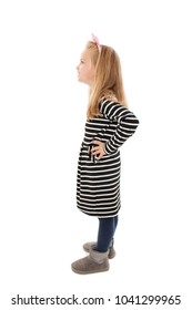 Beautiful little girl standing looking on copy space. Isolated on white background