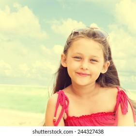 beautiful little girl in sunglasses seaside