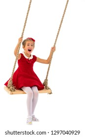 Beautiful little girl swinging on a swing. The concept of family happiness, summer holidays. Isolated on white background.