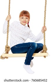 Beautiful little girl swinging on swing. The concept of family happiness, child development, sports education and summer recreation. Isolated on white background.
