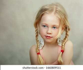 beautiful little girl thinking and looking outside the picture