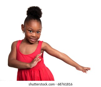 Beautiful little girl wearing red dress dances