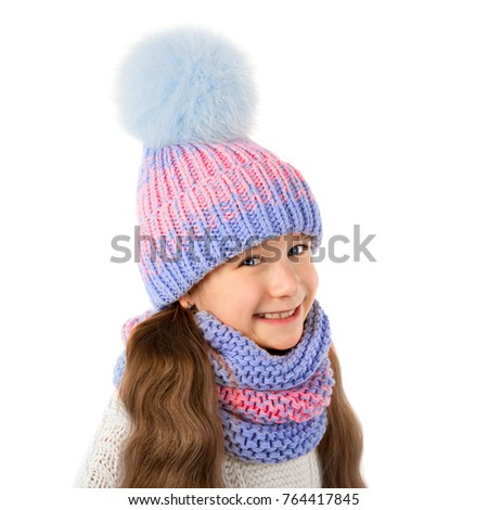 c3b35a4a35c86f Beautiful little girl in winter warm hat and scarf isolated on white.  Children winter clothes