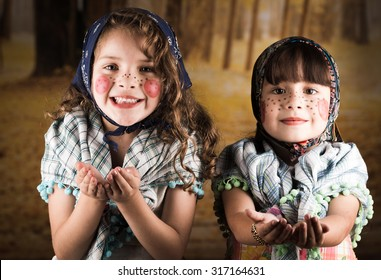 Beautiful little girls dressed as a traditional witches asking trick or treat