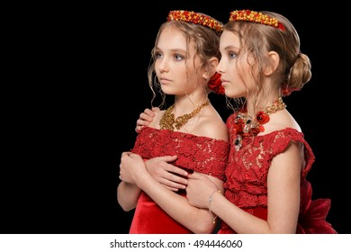 beautiful  little girls in red dresses
