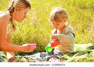 beautiful little with her mother girl on nature