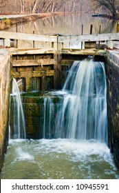 beautiful little lock on a small canal with waterfalls streaming through