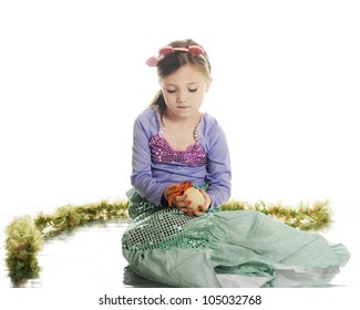 A beautiful little mermaid carefully holding a hermit crab.  On a white background.