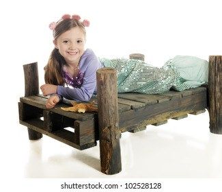 A beautiful little mermaid happily laying on a rustic wood dock with a star fish.  On a white background.