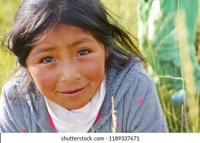 Beautiful little native american girl in the countryside.