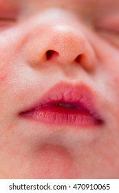 Beautiful little newborn baby's tiny nose and mouth closeup.