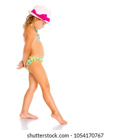 18501f7bebe5 Beautiful little tanned girl in a swimsuit and a hat. The concept of summer  family