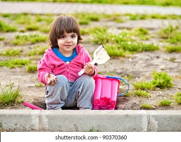 Beautiful little toddler girl playing outdoors