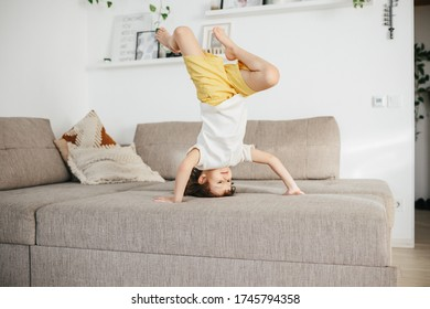 Beautiful little toddler tumbling on sofa at home. Child Learn To Tumble. Tumbling Tutorial. Gymnastics at Home, Tricks