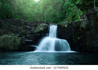 beautiful little waterfall at tropical forest of Koh Kood island Trat province Thailand in bright dreamy hazy day light shot with long exposure for make a water flowing look to show a beauty in nature