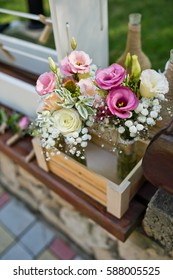 beautiful live flowers in vases baskets on a table decoration