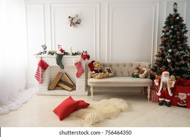 A beautiful living room decorated for Christmas with Christmas tree and presents under it