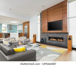 Beautiful living room and kitchen in new contemporary style luxury home. Features beautiful fireplace and fireplace surround.
