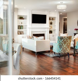 Beautiful Living Room in New Home, as Seen Through Exterior Doorway